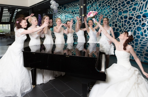 Student brides around piano on Porvoo Campus